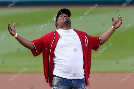 Capitol Police officer Eugene Goodman reacts after throwing out the first pitch before the Washington Nationals baseball game against the New York Mets, in Washington