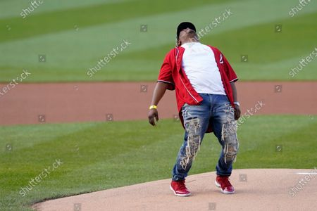 Stock Picture of Capitol Police officer Eugene Goodman reacts after throwing out the first pitch before the Washington Nationals baseball game against the New York Mets, in Washington