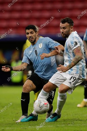 Argentina's Nicolas Otamendi, right, and Uruguay's Luis Suarez battle for the ball during a Copa America soccer match at the National Stadium in Brasilia Brazil