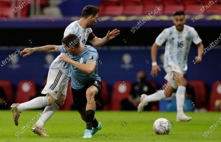 Uruguay's Jose Gimenez, center, stops Argentina's Lionel Messi during a Copa America soccer match at the National Stadium in Brasilia Brazil