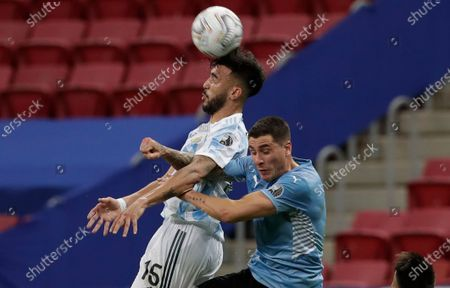 Argentina's Nicolas Gonzalez, left, and Uruguay's Jose Gimenez go for a header during a Copa America soccer match at the National Stadium in Brasilia Brazil