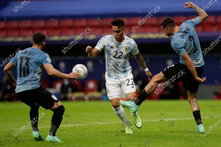 Argentina's Lautaro Martinez, center, battles for the ball with Uruguay's Giovanni Gonzalez, left, and Jose Gimenez during a Copa America soccer match at the National Stadium in Brasilia Brazil