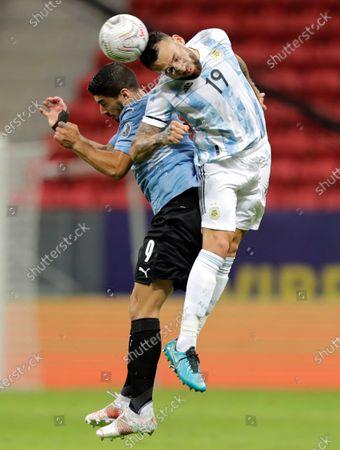 Argentina's Nicolas Otamendi (R) in action against Uruguay's Luis Suarez (L) during the Copa America group B soccer match between Argentina and Uruguay at the Mane Garrincha Stadium in Brasilia, Brazil, 18 June 2021.