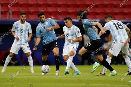 Argentina's Marcos Acuna (C) in action against Uruguay's Luis Suarez (C-L) and Edinson Cavani (C-R), during the Copa America group B soccer match between Argentina and Uruguay at the Mane Garrincha Stadium in Brasilia, Brazil, 18 June 2021.