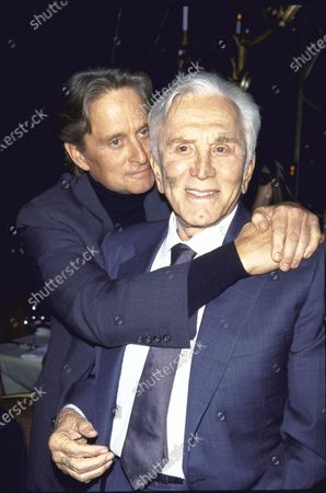 (L-R) Actor Michael Douglas and his father, actor Kirk Douglas, at film premiere of Kirk's Diamonds.