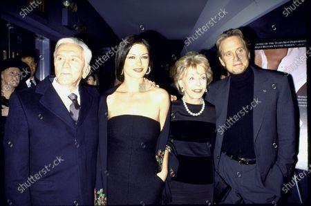 (L-R) Actor Kirk Douglas, actress Catherine Zeta- Jones, Douglas Sr.'s wife Anne and his son, actor Michael Douglas at film premiere of Kirk's Diamonds.