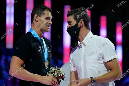 Stock Image of Michael Andrew talks to Michael Phelps at the medal ceremony for the men's 200 individual medley during wave 2 of the U.S. Olympic Swim Trials, in Omaha, Neb