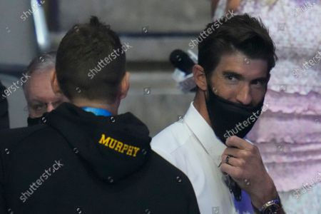 Michael Phelps talks to Ryan Murphy during wave 2 of the U.S. Olympic Swim Trials, in Omaha, Neb