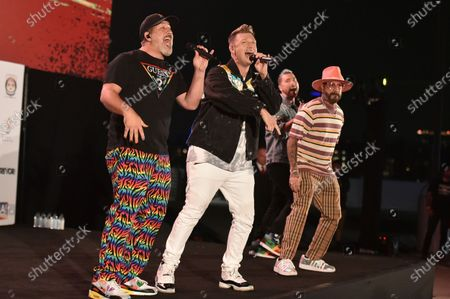 Joey Fatone, from left, Nick Carter, AJ McLean and Lance Bass perform at Bingo Under the Stars, at The Grove in Los Angeles