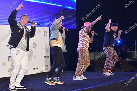 Stock Image of Joey Fatone, from left, Nick Carter, AJ McLean and Lance Bass perform at Bingo Under the Stars, at The Grove in Los Angeles