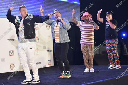 Stock Picture of Nick Carter, from left, Lance Bass, AJ McLean and Joey Fatone perform at Bingo Under the Stars, at The Grove in Los Angeles