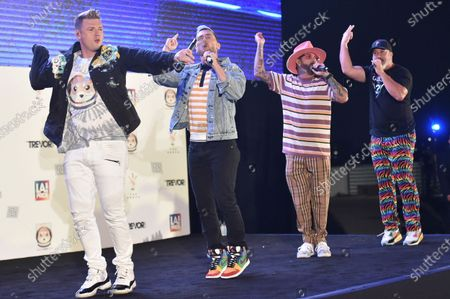 Nick Carter, from left, Lance Bass, AJ McLean and Joey Fatone perform at Bingo Under the Stars, at The Grove in Los Angeles