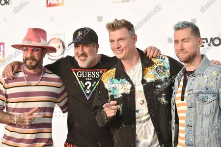 McLean, from left, Joey Fatone, Nick Carter and Lance Bass attend Bingo Under the Stars, at The Grove in Los Angeles