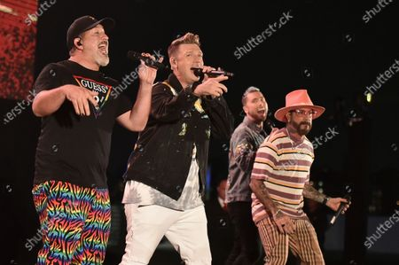 Stock Photo of Joey Fatone, from left, Nick Carter, AJ McLean and Lance Bass perform at Bingo Under the Stars, at The Grove in Los Angeles