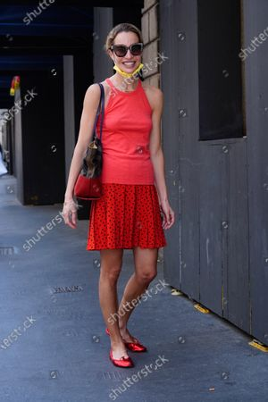 Micol Sabbadini wearing a red tank top, black polka dot mini skirt and red flat shoes is seen during Milan Fashion Week Men's Collection Spring/Summer 2022 in Milan
