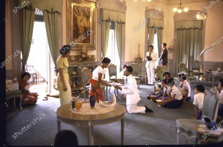 Thailand's Princess Ubolratana (2L) receiving presents from palace employees on her birthday as her mother, Queen Sirikit (L) looks on.