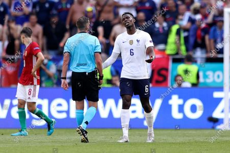 France's Paul Pogba, right, protests with British referee Michael Oliver during the Euro 2020 soccer championship group F match between Hungary and France, at the Ferenc Puskas stadium, in Budapest