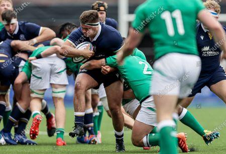 Scotland vs Ireland. Scotland's Patrick Harrison is tackled by Ronan Loughnane of Ireland