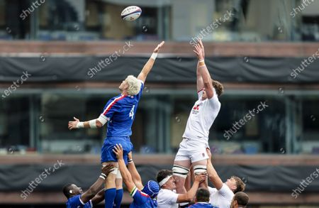 England vs France. France's Joshua Brennan competes in the air with Alex Groves of England