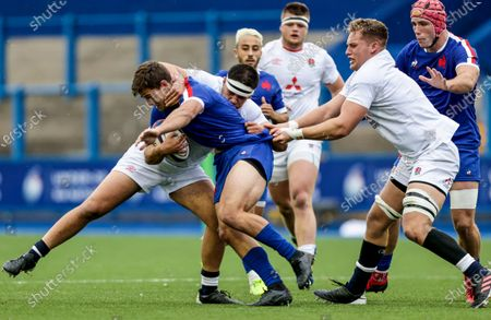 England vs France. France's Alfred Parisien is tackled by Lucas Brooke and Jack Clement of England