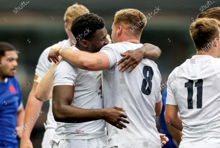 England vs France. England's Emeka Ilione celebrates after the game with Jack Clement