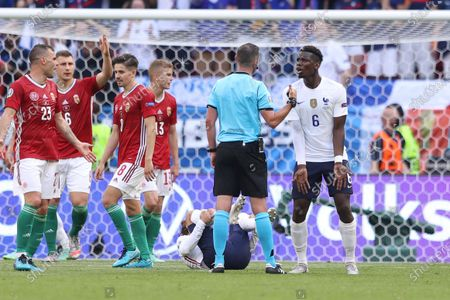 France's Paul Pogba takes on British referee Michael Oliver during the Euro 2020 soccer championship group F match between Hungary and France, at the Ferenc Puskas stadium, in Budapest