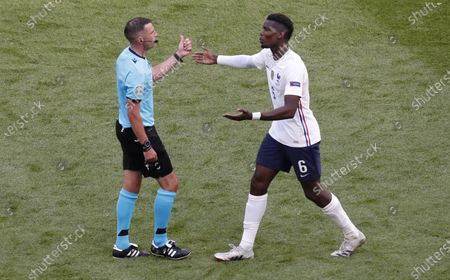 Stock Picture of Paul Pogba (R) of France and English referee Michael Oliver reacts during the UEFA EURO 2020 group F preliminary round soccer match between Hungary and France in Budapest, Hungary, 19 June 2021.