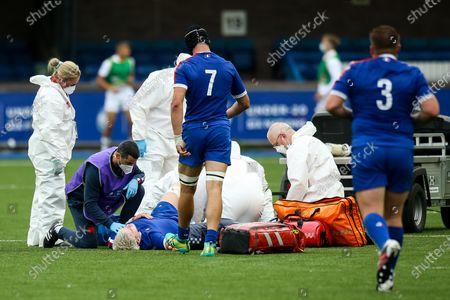 England vs France. France's Joshua Brennan receives medical attention