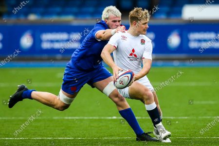 Stock Picture of England vs France. England's Fin Smith comes up against Joshua Brennan of France
