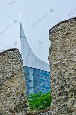 Stock Photo of Reading Abbey ruins with The Blade, the tallest building in Reading behind, mixing old and new.People of Reading came together today to celebrate 900 years since Reading Abbey, one of EuropeÕs largest royal monasteries, was founded by King Henry I of England.Reading Abbey was founded in 1121 and was one of the wealthiest and most important monasteries of medieval England.Today, the remains of the Abbey can be found throughout the former precinct known as the Abbey Quarter in the heart of Reading, sharing the site with the Victorian Reading Prison buildings. It is a site of huge archaeological and historic importance.