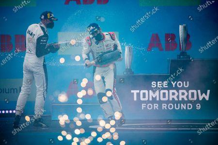 Edoardo Mortara (CHE), Venturi Racing, 3rd position, and Lucas Di Grassi (BRA), Audi Sport ABT Schaeffler, 1st position, spray Champagne on the podium during the 2021 Formula E Round 8 - Puebla E-Prix