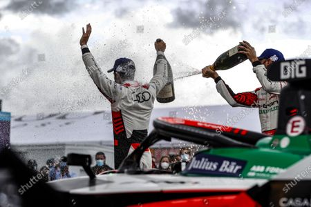 Lucas Di Grassi (BRA), Audi Sport ABT Schaeffler, 1st position, and Rene Rast (DEU), Audi Sport ABT Schaeffler, 2nd position, celebrate with Champagne on the podium during the 2021 Formula E Round 8 - Puebla E-Prix