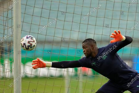 Switzerland's goalkeeper Yvon Mvogo makes a save during a team training session at the Baku Olympic Stadium in Baku, Azerbaijan, the day before the Euro 2020 soccer championship group A match between Switzerland and Turkey