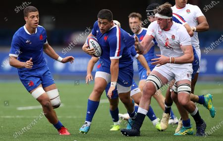 Connor Sa of France is tackled by Jack Clement of England.