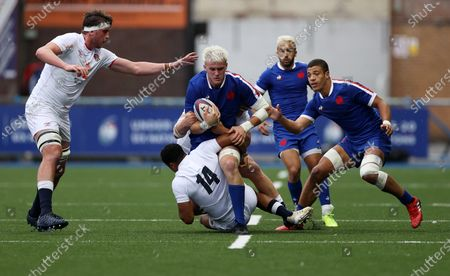 Joshua Brennan of France is tackled by Deago Bailey of England.