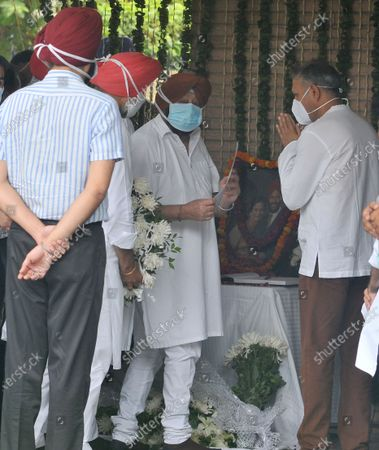 """Stock Image of Punjab Chief Minister Capt. Amarinder Singh during a condolence visit at Milkha Singh's home in Sector 8,, on June 19, 2021 in Chandigarh, India. Milkha Singh died on Friday of complications due to coronavirus disease (Covid-19), at the age of 91, after a month-long battle with Covid-19 in Chandigarh. Milkha, famously known by the sobriquet 'Flying Sikh', had contracted the viral contagion last month and was admitted to the Intensive Care Unit (ICU) of a top hospital in Chandigarh due to """"dipping levels of oxygen""""."""