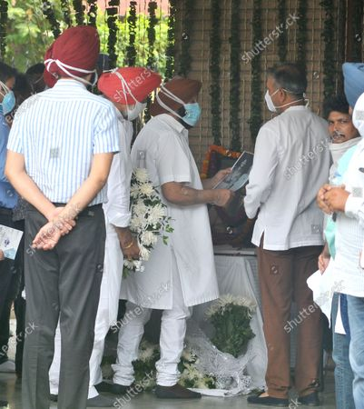 """Punjab Chief Minister Capt. Amarinder Singh during a condolence visit at Milkha Singh's home in Sector 8,, on June 19, 2021 in Chandigarh, India. Milkha Singh died on Friday of complications due to coronavirus disease (Covid-19), at the age of 91, after a month-long battle with Covid-19 in Chandigarh. Milkha, famously known by the sobriquet 'Flying Sikh', had contracted the viral contagion last month and was admitted to the Intensive Care Unit (ICU) of a top hospital in Chandigarh due to """"dipping levels of oxygen""""."""