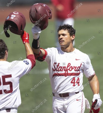 Stanford's Christian Robinson, right, celebrates with Kody Huff (25) after hitting a two-run home run against North Carolina State in the seventh inning in the opening baseball game of the College World Series, at TD Ameritrade Park in Omaha, Neb