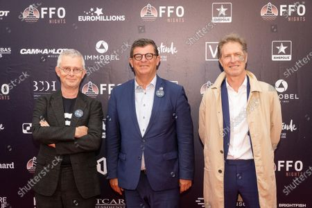 Oostende mayor Bart Tommelein (C) and Peter Craeymeersch (R) pictured during the first edition of the FFO Night, an alternative to the Oostende Film festival, Saturday 19 June 2021, in Oostende. The FFO Night starts with the avant-premiere of the film 'My father is a saucisse'.