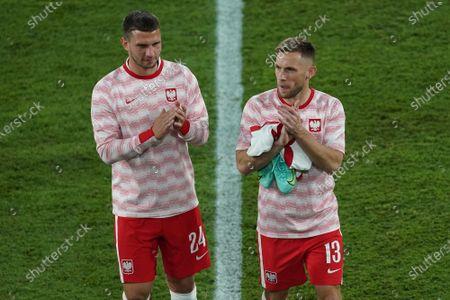 Jakib Swierczok and Maciej Rybus of Poland