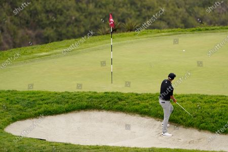 Matt Jones plays a shot from a bunker on the third hole during the third round of the U.S. Open Golf Championship, at Torrey Pines Golf Course in San Diego