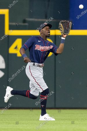 Minnesota Twins center fielder Nick Gordon attempt to make a play during the first inning of a baseball game against the Texas Rangers in Arlington, Texas