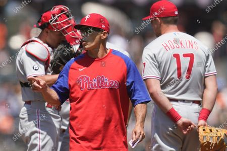 Philadelphia Phillies' manager Joe Girardi, foreground, gestures after making a pitching change during the third inning of a baseball game against the San Francisco Giants in San Francisco