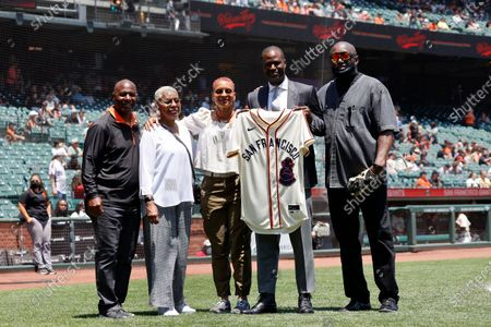In honor of Juneteenth, Former San Francisco Giants players Mike Felder (L) and Jeffrey Leonard (R) with Giants employee Randy Wells (2-R) presents a San Francisco Sea Lions Jersey to Monica Franks, and her mother, Maria Bartlow, family member of Toni Stone during a presentation, at Oracle Park in San Francisco, California, USA, 19 June 2021. The late Stone was the first female known to play on a professional men's baseball team. Stone was a member of the Negro Leagues in which she played for the Sea Lions and later the Indianapolis Clowns. The San Francisco Giants will wear replica uniforms of the San Francisco Sea Lions marking the 75th anniversary of the West Coast Negro Baseball Association to celebrate Juneteenth in their MLB game against the Philadelphia Phillies California. Prior to the establishment of the San Francisco Sea Lions, who played for just one season, there was the San Francisco Cubs. It was the defunct Cubs organization, with a bear cub on their uniform, who gave those old uniforms to the Sea Lions for the 1946 season.