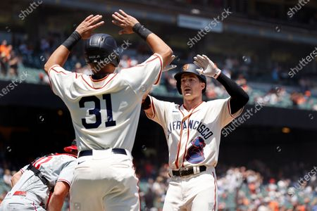 San Francisco Giants Mike Yastrzemski (R) is greeted at home plate by San Francisco Giants LaMonte Wade Jr (C) after hitting a two-run home run off Philadelphia Phillies starting pitcher Aaron Nola during the first inning of their MLB game at Oracle Park in San Francisco, California, USA, 19 June 2021. The Giants will wear replica uniforms of the San Francisco Sea Lions marking the 75th anniversary of the West Coast Negro Baseball Association to celebrate Juneteenth. Prior to the establishment of the San Francisco Sea Lions, who played for just one season, there was the San Francisco Cubs. It was the defunct Cubs organization, with a bear cub on their uniform, who gave those old uniforms to the Sea Lions for the 1946 season.