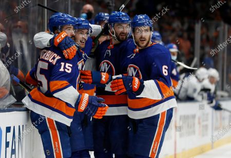 New York Islanders center Mathew Barzal (2nd L) celebrates his goal against the Tampa Bay Lightning with teammates right wing Cal Clutterbuck (15), defensemen Adam Pelech (3) Ryan Pulock (6) during the second period of Game 4 of the NHL hockey Stanley Cup semifinals, in Uniondale, N.Y