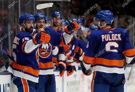 Stock Photo of New York Islanders center Mathew Barzal (13) celebrates his goal against the Tampa Bay Lightning with teammates right wing Cal Clutterbuck (15), defenseman Ryan Pulock (6) during the second period of Game 4 of the NHL hockey Stanley Cup semifinals, in Uniondale, N.Y