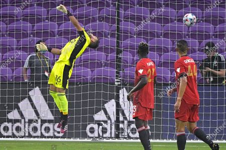 Ball struck by Orlando City forward Nani gets past Toronto FC goalkeeper Quentin Westberg (16) for a goal as Toronto defenders Chris Mavinga (23) and Omar Gonzalez (44) watch during the first half of an MLS soccer match, in Orlando, Fla