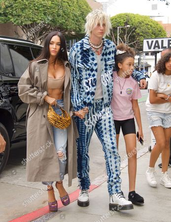 Megan Fox and Machine Gun Kelly were spotted out in Santa Monica after his Wild Rooftop Concert in Venice. The couple have grown closer and closer, as they spend time together as a family. They were joined by his daughter as the trio walked arm in arm into the restaurant