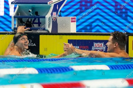 Nathan Adrian congratulates Caeleb Dressel after the men's 50 freestyle during wave 2 of the U.S. Olympic Swim Trials, in Omaha, Neb